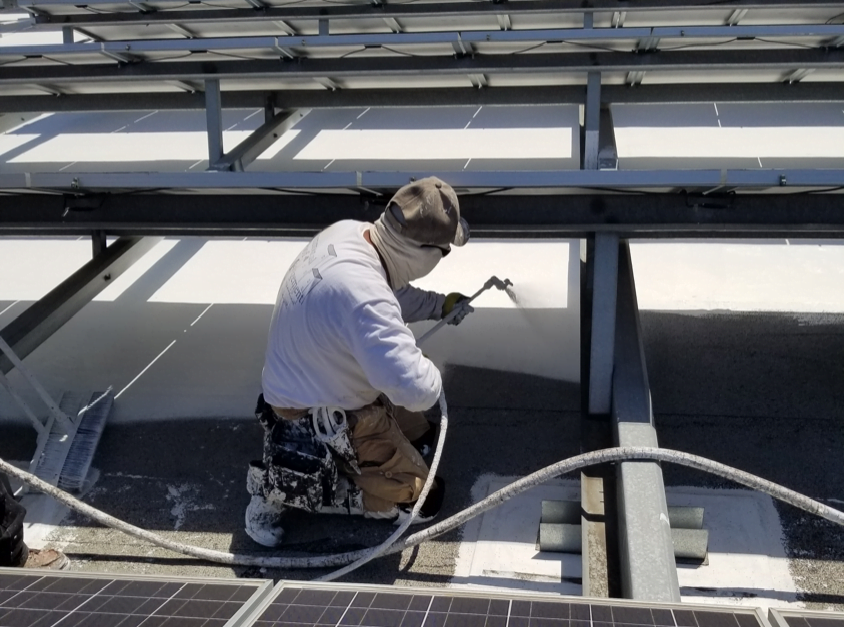 Spraying cool roof under solar panels